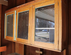 the glass doors on the original cabinetry in our American System-Built home