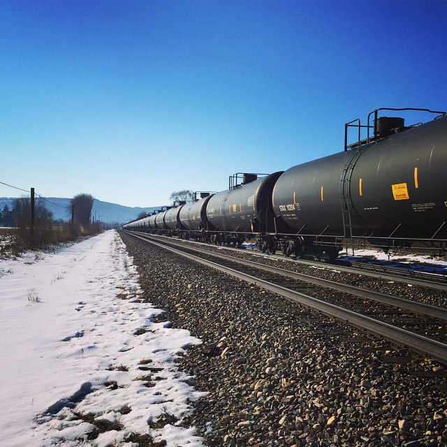 A freight train pulling hundreds of cars of crude oil