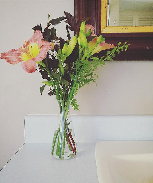 A bouquet of wildflowers in the bathroom